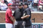 Arkansas baseball coach Dave Van Horn discusses a controversial call during the third inning with some of the unidentified game umpires during the first game of a double-header against Mississippi State in Starkville, Miss., Saturday, April 21, 2018.