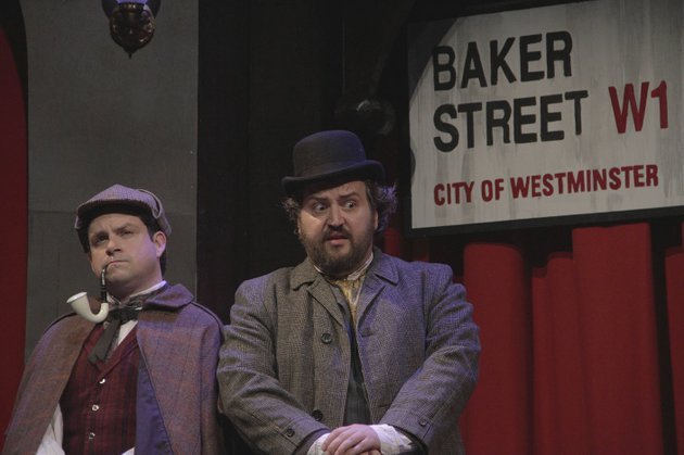 courtesy-photo-patrick-hailey-is-sherlock-holmes-left-and-bruce-warren-is-dr-watson-in-the-hound-of-the-baskervilles-opening-april-25-at-theatresquared-the-comedy-was-co-produced-with-virginia-stage-company-in-norfolk-where-its-already-had-a-hilarious-and-successful-run-says-t2-spokeswoman-joanna-sheehan-bell-it-was-especially-rewarding-that-we-were-able-to-book-some-of-our-favorite-t2-alums-on-this-show-as-a-result-reuniting-all-three-of-these-cast-members-from-our-production-of-peter-and-the-starcatcher-with-director-mark-shanahan