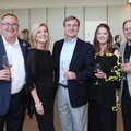 Brian and Tammy Chase (from left), Jeff Palmer and Janet and Frank Seaton help support Bost Inc. at ...