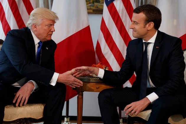 in-this-may-25-2017-file-photo-us-president-donald-trump-shakes-hands-with-french-president-emmanuel-macron-right-during-a-meeting-at-the-us-embassy-in-brussels-macron-arrives-monday-april-23-2018-in-washington-for-the-first-state-visit-of-trumps-presidency-the-two-men-have-an-unlikely-friendship-despite-strong-differences-on-areas-such-as-climate-change-ap-photoevan-vucci-file