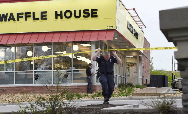law-enforcement-officials-work-the-scene-of-a-fatal-shooting-at-a-waffle-house-on-sunday-in-nashville-tenn