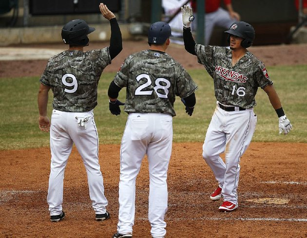 arkansas-travelers-second-baseman-chris-mariscal-right-celebrates-with-teammates-dario-pizzano-and-ryon-healy-after-his-three-run-home-run-sunday-against-the-springfield-cardinals