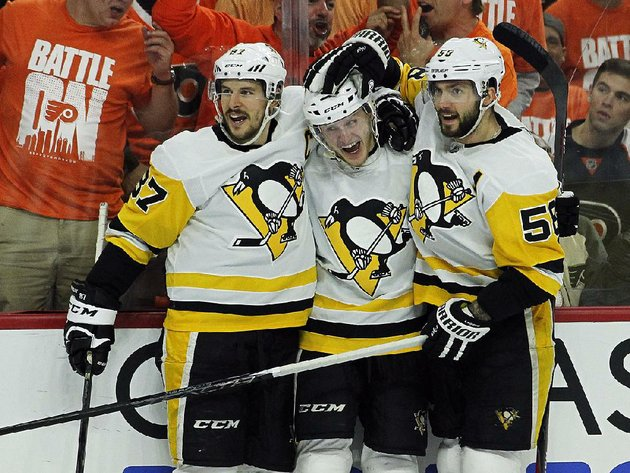 pittsburgh-penguins-center-jake-guentzel-center-celebrates-with-teammates-sidney-crosby-left-and-kris-letang-right-after-scoring-in-the-third-period-sunday-in-philadelphia-guentzel-scored-four-goals-in-the-penguins-8-5-victory-over-the-philadelphia-flyers