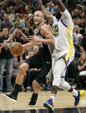 San Antonio Spurs guard Manu Ginobili (left) drives past Golden State Warriors forward Draymond Green during Sunday's game in San Antonio.
