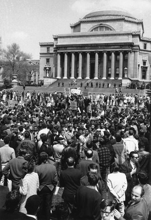 In this April 27, 1968 file photo, demonstrators and students protest at the plaza in front of Columbia University's Low Memorial Library in New York. Fifty years ago, students occupied five buildings at the university and shut down the Ivy League campus in a protest over the school's ties to a military think tank and what protesters saw as racism toward Columbia's Harlem neighbors. More than 700 protesters were arrested and more than 130 were injured when police retook the occupied buildings, during what was part of a year of global turmoil. (AP Photo, File)