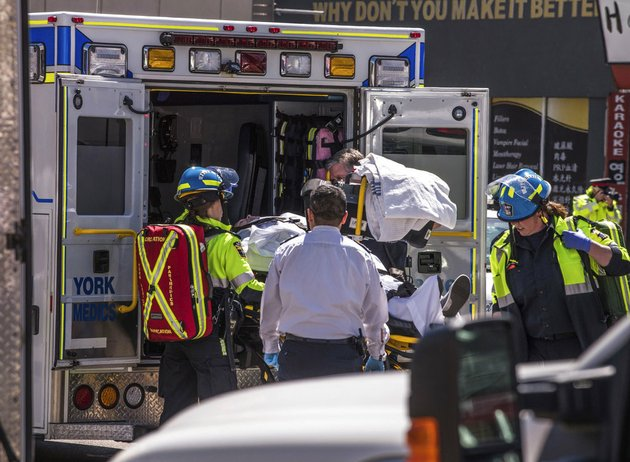 an-injured-person-is-put-into-the-back-of-an-ambulance-in-toronto-after-a-van-mounted-a-sidewalk-crashing-into-a-crowd-of-pedestrians-monday-april-23-2018
