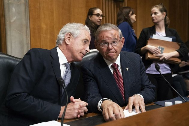 senate-foreign-relations-committee-chairman-bob-corker-left-r-tenn-and-sen-robert-menendez-d-nj-oversee-the-vote-on-president-donald-trumps-nominee-for-secretary-of-state-mike-pompeo-who-has-faced-considerable-opposition-before-the-panel-monday-on-capitol-hill