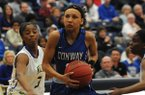 Conway's Alexis Tolefree drives to the basket during a game against North Little Rock on Monday, March 9, 2015, during the Class 7A semifinals at Har-Ber High School in Springdale.
