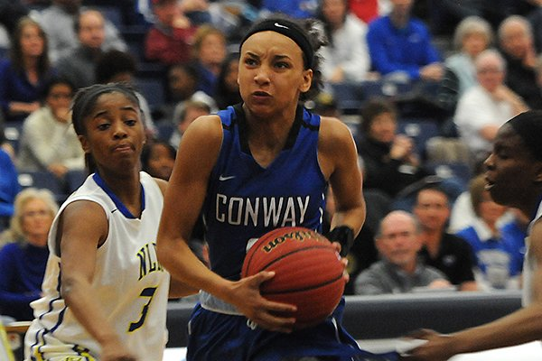 conways-alexis-tolefree-drives-to-the-basket-during-a-game-against-north-little-rock-on-monday-march-9-2015-during-the-class-7a-semifinals-at-har-ber-high-school-in-springdale