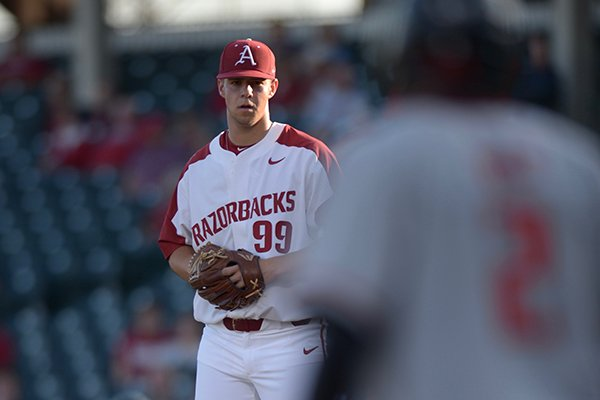 Arkansas pitcher Jackson Rutledge stares down a runner during a game against Texas Tech on Tuesday, April 24, 2018, in Fayetteville.