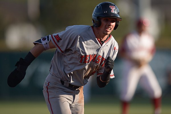 Texas Tech second baseman Gabe Holt heads to third base Tuesday, April 24, 2018, during the first inning against Arkansas at Baum Stadium.