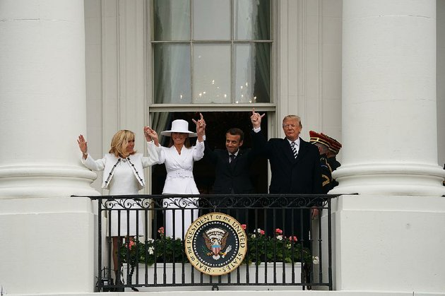 brigitte-macron-and-melania-trump-join-their-husbands-on-the-white-house-balcony-tuesday-during-a-state-arrival-ceremony-for-french-president-emmanuel-macron
