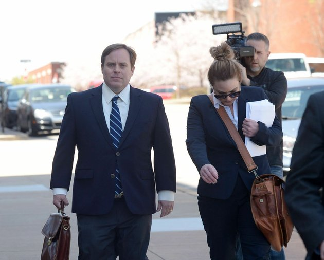 former-state-sen-jon-woods-left-walks-april-4-alongside-his-attorneys-outside-the-john-paul-hammerschmidt-federal-building-in-fayetteville