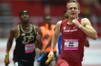 Arkansas' John Winn competes in the 4x400-meter relay Saturday, Feb. 10, 2018, during the Tyson Invitational in the Randal Tyson Track Center in Fayetteville.