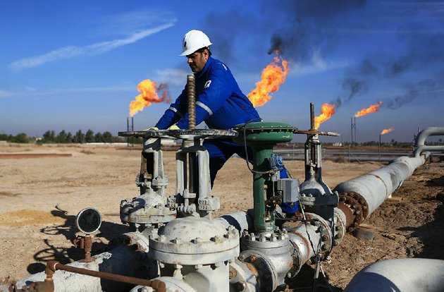 an-iraqi-works-in-an-oil-field-north-of-basra-oil-revenue-makes-up-nearly-95-percent-of-iraqs-budget