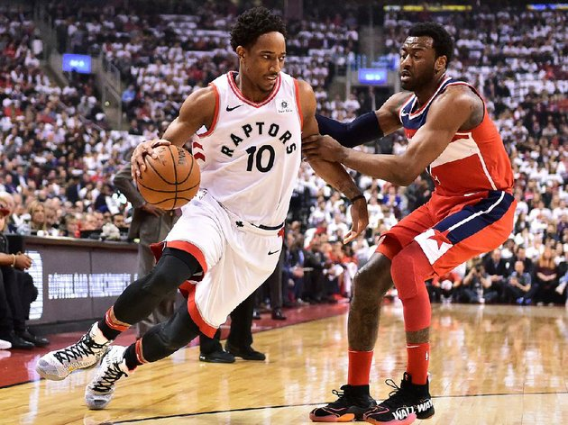 torontos-demar-derozan-drives-around-washingtons-john-wall-on-wednesday-night-in-the-raptors-108-98-victory-in-toronto-derozan-scored-a-game-high-32-points