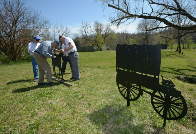 nwa-democrat-gazetteandy-shupe-bob-ashbaugh-from-left-gary-burney-rick-johnson-and-john-thompson-all-volunteers-with-the-elm-springs-heritage-association-install-silhouettes-of-civil-war-soldiers-last-week-in-the-citys-park-adjacent-to-the-associations-facility-in-elm-springs-the-park-was-once-the-site-of-a-large-camp-of-confederate-soldiers