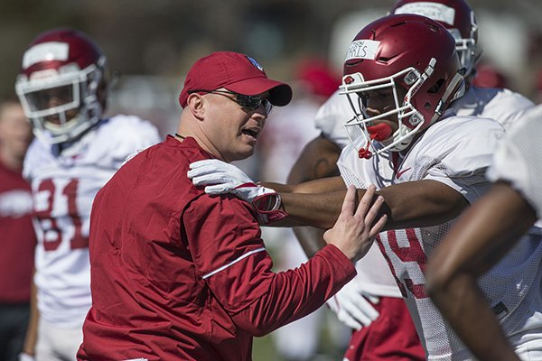 Arkansas receivers coach Justin Stepp works with receiver Tyson Morris on Saturday, March 3, 2018, in Fayetteville.
