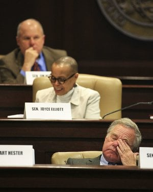 State senators and legislative tax overhaul task force members Jim Hendren (top), R-Sulphur Springs, Joyce Elliott, D-Little Rock, and Keith Ingram, D-West Memphis, take part in Thursday's session.