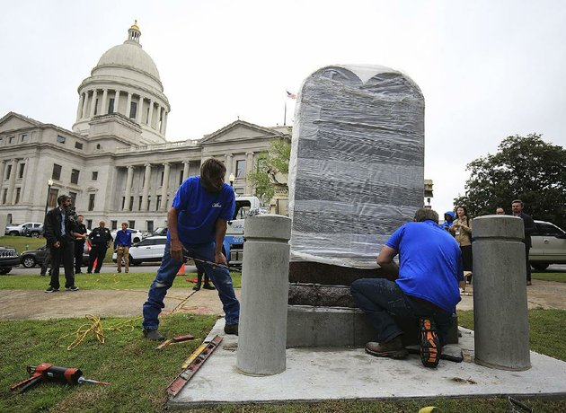employees-from-wilbert-memorials-install-the-new-ten-commandments-monument-thursday-at-the-state-capitol-the-monument-replaces-one-destroyed-last-year