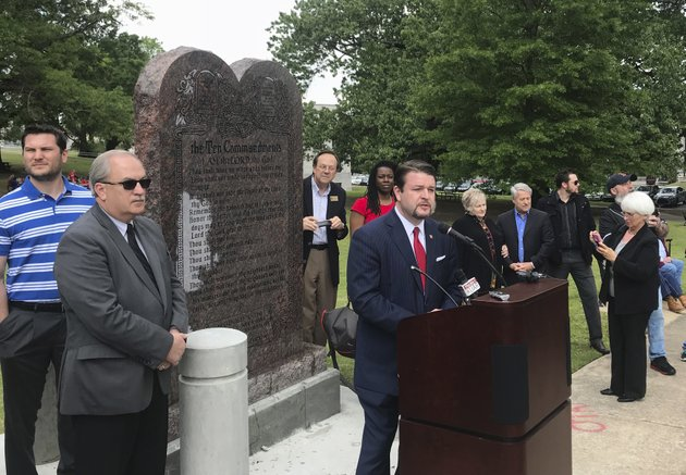 arkansas-republican-state-sen-jason-rapert-speaks-at-the-unveiling-of-a-ten-commandments-monument-outside-the-arkansas-state-capitol-in-little-rock-on-thursday-april-26-2018-the-display-replaces-a-monument-that-was-destroyed-nearly-a-year-ago-rapert-sponsored-the-legislation-requiring-the-privately-funded-monument-on-state-capitol-grounds-ap-photoandrew-demillo