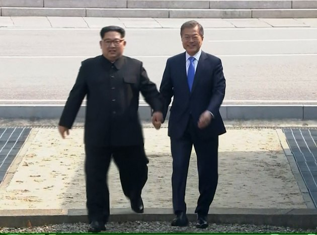 Image result for moon and kim jong un shal hands