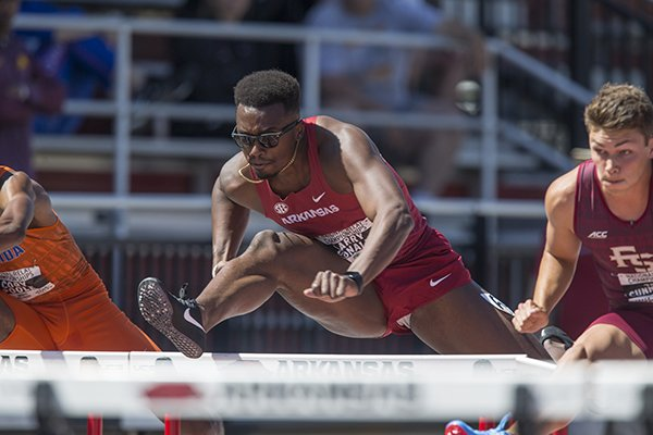 Larry Donald of Arkansas runs in the third heat of the men's 110 meter hurdles Friday, April 27, 2018, during the National Relay Championships at John McDonnell Field in Fayetteville.
