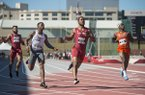 Roy Ejiakuekwu (from left) of Arkansas, Mustaqeem Williams of Tennessee, Kenzo Cotton of Arkansas and Ryan Clark of Florida run through the finish in the final heat of the men's 100 meter dash Friday, April 27, 2018, during the National Relay Championships at John McDonnell Field in Fayetteville.