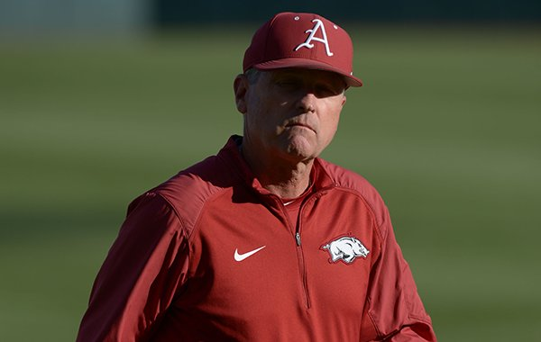 Arkansas coach Dave Van Horn walks to the dugout prior to a game against Alabama on Friday, April 27, 2018, in Fayetteville.