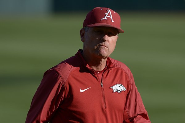arkansas-coach-dave-van-horn-walks-to-the-dugout-prior-to-a-game-against-alabama-on-friday-april-27-2018-in-fayetteville