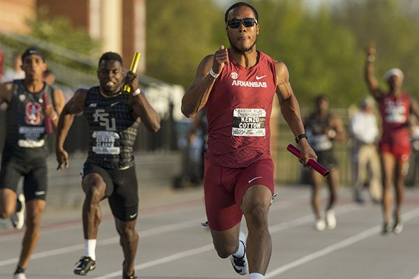 Kenzo Cotton runs to victory for Arkansas on the final leg of the men's 4x100 meter relay Saturday, April 28, 2018, during the National Relay Championships at John McDonnell Field in Fayetteville.
