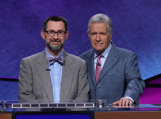 jake-allen-a-gifted-and-talented-education-teacher-at-huntsville-intermediate-school-in-huntsville-poses-with-jeopardy-host-alex-trebek-photo-courtesy-of-jeopardy-productions-inc