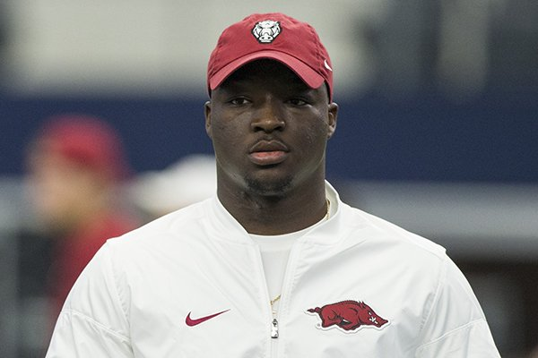 former-arkansas-running-back-rawleigh-williams-watches-warmups-prior-to-a-game-against-texas-am-on-saturday-sept-23-2017-in-arlington-texas