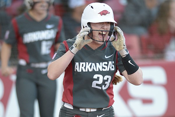 Arkansas Hannah McEwen celebrates after scoring a run Friday, March 30, 2018, during the fourth inning against Mississippi State at Bogle Park in Fayetteville.