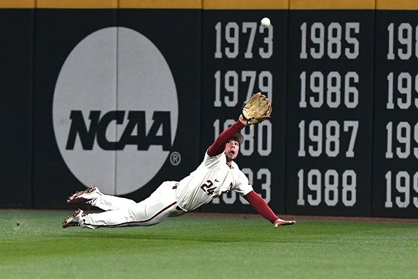 Arkansas outfielder Dominic Fletcher lays out to make a catch during a game against Texas on Tuesday, March 13, 2018, in Fayetteville.