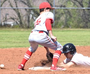 RICK PECK/SPECIAL TO MCDONALD COUNTY PRESS Tyler Stoutsenberger steals second base during McDonald County's 6-5 win over Carl Junction on April 28 at MCHS.