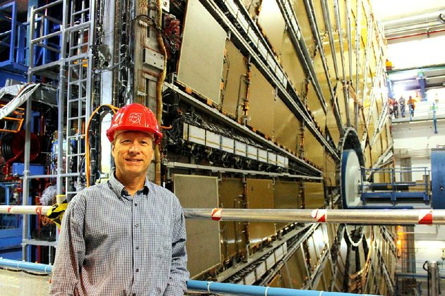 experimental-particle-physicist-michael-strauss-stands-in-front-of-the-atlas-detector-one-of-the-two-multipurpose-large-hadron-collider-detectors-at-switzerlands-cern-laboratory-strauss-will-be-the-featured-guest-at-the-third-installment-of-the-event-series-city-center-conversations-conversations-about-god-life-and-faith-in-the-city-at-little-rocks-statehouse-convention-center-on-tuesday