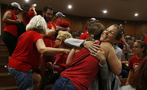 Schools still shut as Arizona OKs teacher raises