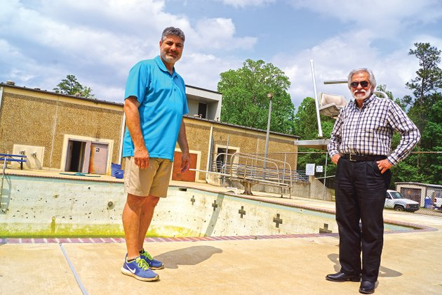 joel-stanton-left-director-of-the-sheridan-parks-and-recreation-department-and-sheridan-mayor-joe-c-wise-jr-await-workers-who-will-refurbish-the-swimming-pool-at-the-sheridan-community-center-the-pool-and-splash-pad-will-open-memorial-day-weekend