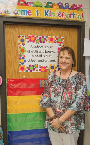 """Kim Rupard stands in her kindergarten classroom at McRae Elementary School in Searcy. Rupard, who is in her 28th year at the school, is the Searcy School District Teacher of the Year. Rupard said school and family """"are my life."""" McRae Elementary School Principal James Gurchiek said, """"She has the heart to be a good teacher."""""""