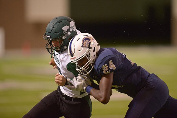 Bentonville West linebacker Kendall Young (24) forces Muskogee, Okla., quarterback Medrano (7) out of bounds during the first quarter of a game Friday Sept. 16, 2016, in Bentonville.