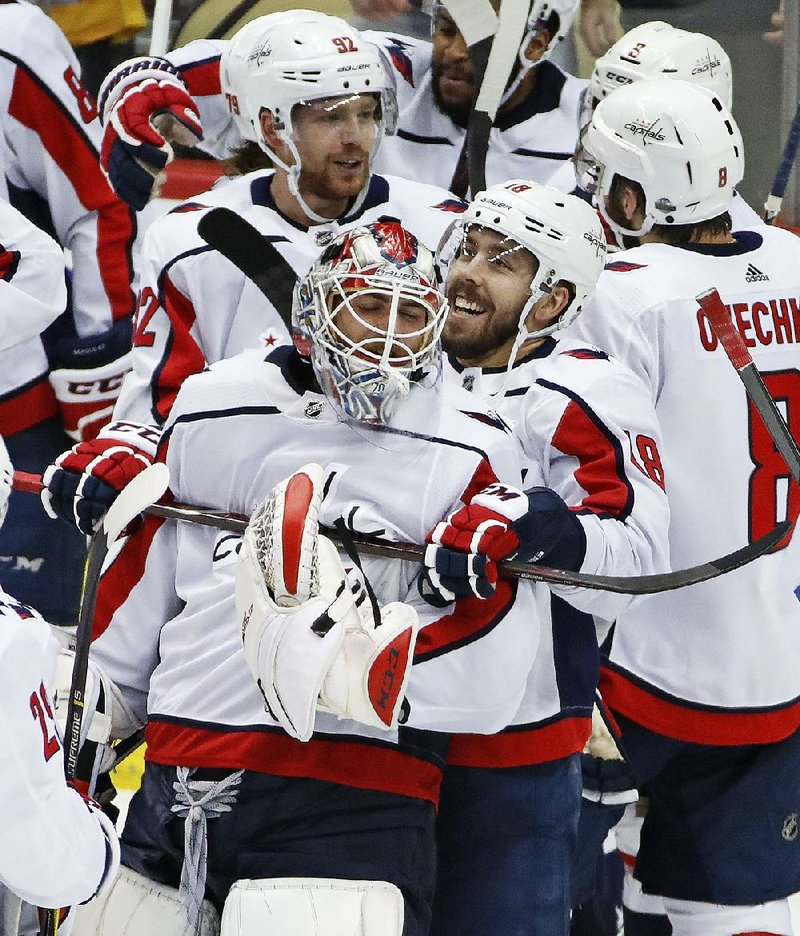 141388e271d Washington Capitals goaltender Braden Holtby (left) and Chandler Stephenson  celebrate after the Capitals defeated the Pittsburgh Penguins on Monday  night to ...