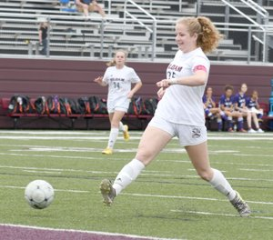 Bud Sullins/Special to the Herald-Leader Siloam Springs senior Megan Hutto takes a stab at a ball during the Lady Panthers' game against El Dorado on May 1. Hutto signed to play college soccer at Northeastern State University in Tahlequah, Okla.