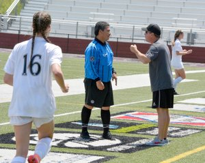 Graham Thomas/Herald-Leader Siloam Springs head coach Brent Crenshaw argues a call with the center official Jose Sosa during Saturday's 6A-West Conference girls championship game. Siloam Springs defeated Benton 5-2.