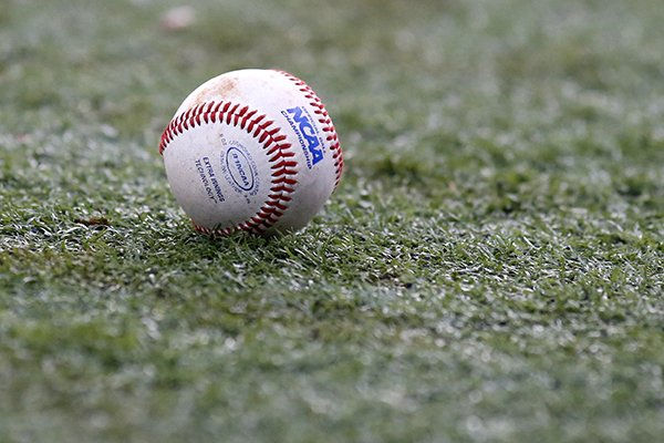 The NCAA logo is seen on a baseball during an NCAA college baseball tournament regional game between Louisiana-Lafayette and Mississippi State in Lafayette, La., Monday, June 2, 2014. (AP Photo/Jonathan Bachman)