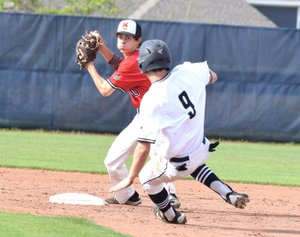 Rick Peck/Special to McDonald County Press McDonald County second baseman Jorden Platter makes the turn as the Mustangs record a double play during a 9-8 loss on May 4 at Bentonville West High School.