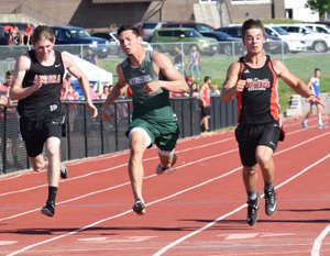 RICK PECK/SPECIAL TO MCDONALD COUNTY PRESS Corbin Jones (right) was McDonald County's lone Big 8 Conference champion after he edged Mount Vernon's Andrew Montemayor in the 100-meter dash at the Big 8 Conference Track and Field Championships held May 7 at MCHS.