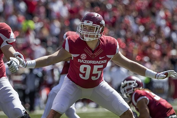 Arkansas' Jake Hall blocks for an extra point during a game against New Mexico State on Saturday, Sept. 30, 2017, in Fayetteville.
