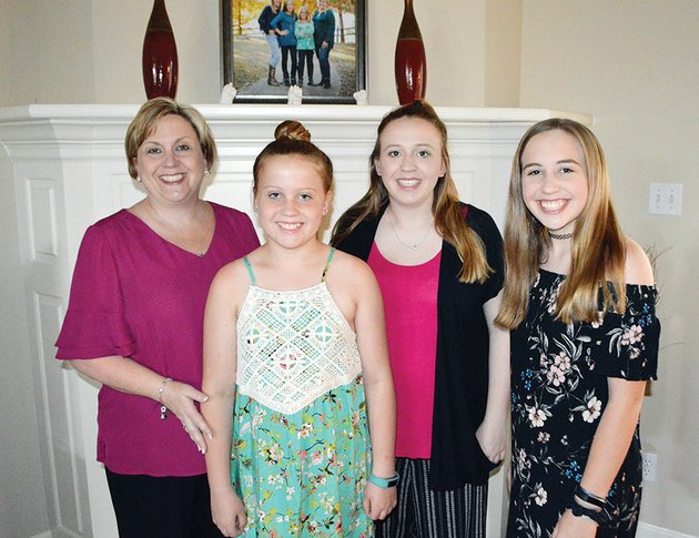 mandy-mcclellan-stands-with-her-three-daughters-in-their-conway-home-from-left-her-daughter-sophie-is-11-abby-is-17-and-keely-is-13-the-two-older-girls-have-cochlear-implants-and-mcclellan-co-founded-arkansas-hands-voices-about-10-years-ago-to-help-other-parents-of-children-with-hearing-loss-theyre-just-normal-kids-she-said-of-her-daughters