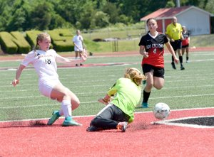 Bud Sullins/Special to Siloam Sunday Siloam Springs freshman Madison Race takes a shot that deflects off Russellville goalkeeper Bailey McGill. Race helped spark the Lady Panthers to rally for a 2-1 victory on Friday in the Class 6A state quarterfinals.